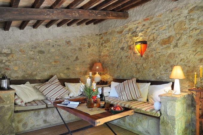 charming-porch-with-sofa-podere-santa-giulia-for-sale-tuscany-pisa-volterra